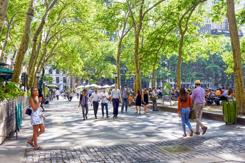 52857331 - new york-june 9: people enjoying a nice walk through bryant park on june 9 2015 in new york city.